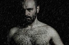 Eyes in the rain. A strong man waiting to start the fight in the rain stock photos