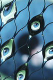Eyes refracted in Water. Droplets in a net Royalty Free Stock Image