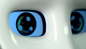 Eyes of the robot are lit and off. Close up stock video footage