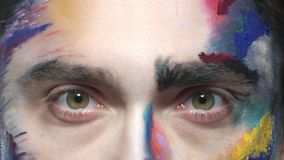 Eyes of scared man. Artistic face makeup macro