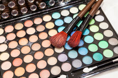 Eyes shadow makeup with two brushes Stock Photo