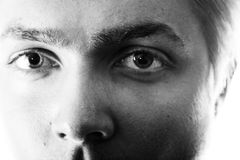 Eyes staring. Black and white closeup of a young man's eyes staring Royalty Free Stock Photos