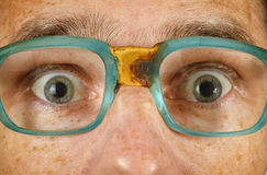 Eyes of surprised person in old spectacles Stock Photo