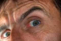 Eyes of terrified man Stock Images