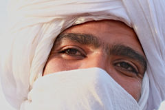 Eyes of Tuareg. Head of Tuareg in white turban with black eyes royalty free stock photo