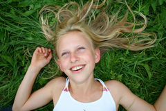 Eyes up. Young blond girl with eyes up in grass Royalty Free Stock Images