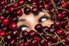Eyes woman in cherry Royalty Free Stock Photos
