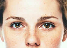 Eyes woman freckle happy young beautiful studio portrait with healthy skin Stock Images