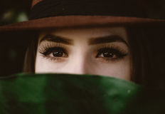 Eyes of woman between hat and scarf Royalty Free Stock Images
