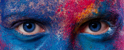 Eyes of woman with paint make-up royalty free stock images