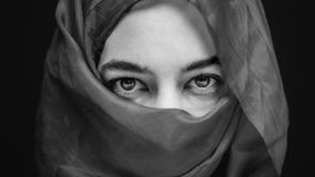 Eyes of woman wrapped in mystery Royalty Free Stock Photography