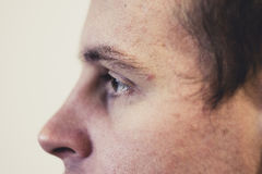 Eyes of a young man at  close distance. Brown eyes of a young man at a close distance Stock Photo
