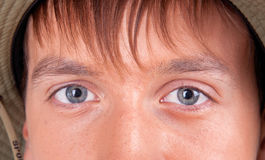 Eyes of a young tourist. On white background Stock Images