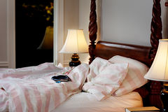 Eyeshade & earplugs on bed. Eyeshade and earplugs on the bed - night scene Royalty Free Stock Photos