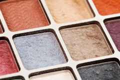 Eyeshadow 3. Closeup of different colored eye shadows Stock Images