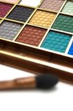 Eyeshadow and brush. Multicolored eye shadows with cosmetics brush Royalty Free Stock Images