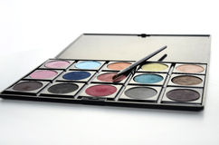 Eyeshadow and brush Royalty Free Stock Image