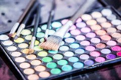 Eyeshadow with brushes Royalty Free Stock Photography