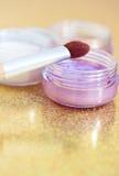 Eyeshadow colors and makeup brush Stock Photo