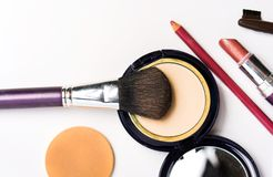Eyeshadow cosmetics with brush and lipstick isolated royalty free stock images