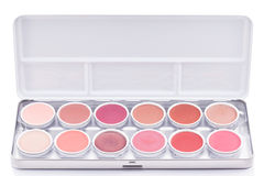 Eyeshadow of different colors over white background Stock Photography