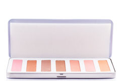 Eyeshadow of different colors over white background Stock Photo