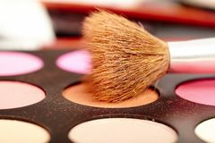 Eyeshadow kit with brush Stock Photo