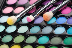 Eyeshadow kit with three makeup brushes Royalty Free Stock Photos