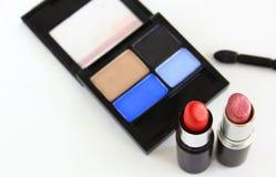 Eyeshadow and lipstick tubes Stock Image