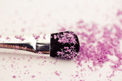 Eyeshadow make-up powder and brush Royalty Free Stock Images