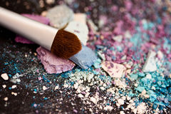 Eyeshadow make-up powder and brush, shallow dof. A still-life of colourful eyeshadow powder and make-up brush Stock Images