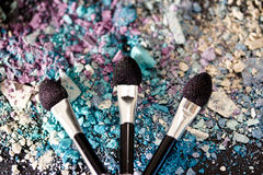 Eyeshadow make-up powder and brushes, shallow dof. A still-life of colourful eyeshadow powder and make-up brushes Royalty Free Stock Photography