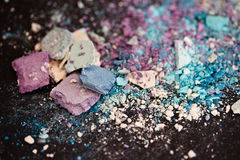 Eyeshadow make-up powder, shallow dof. A still-life of colourful eyeshadow powder and make-up Royalty Free Stock Images