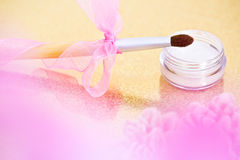 Eyeshadow and makeup brush with bow Royalty Free Stock Photography