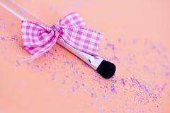 Eyeshadow makeup brush with ribbon Royalty Free Stock Image