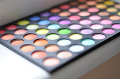 Eyeshadow Palette. Bright and colorful eyeshadow palette. Shining colors in the palette for makeup stock photo