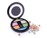 Eyeshadow palette and multicolored blush balls Royalty Free Stock Images