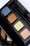 Eyeshadow pallete. Set of the trendy eyeshadows and applicator brush in a close-up view Stock Photo