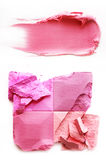 Eyeshadow pink and lipstick pink on a white. Eyeshadow pink and lipstick pink crushed and mixed isolated on a white background Royalty Free Stock Images
