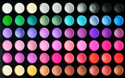 Eyeshadow set. Make-up colorful eyeshadow palettes, as background stock images