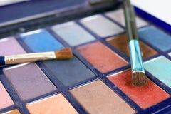 Eyeshadows and brushes Royalty Free Stock Images