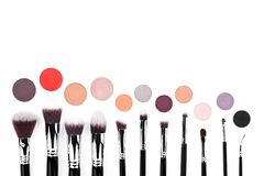 Eyeshadows and brushes set for make up isolated on white royalty free stock photography