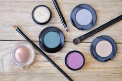 Eyeshadows And Brushes On Wood Table Stock Image