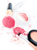 Eyeshadows and cosmetic brush Royalty Free Stock Photography