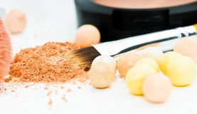 Eyeshadows and cosmetic brush Royalty Free Stock Images