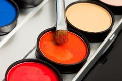 eyeshadows and cosmetic brush Stock Image