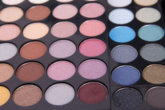 Eyeshadows. Detail of eyeshadows, big palette of eyeshadows Royalty Free Stock Photography