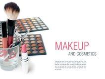 Eyeshadows, lipstick, eyelash curlers and  make-up brushes Royalty Free Stock Image