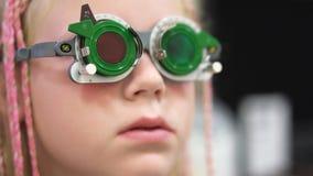 Eyesight check. Caucasian girl who have vision disabilities.Medical treatment and Rehabilitation.  stock photos