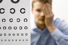 Eyesight check. male patient under eye vision examination. focus Stock Photos
